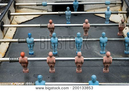 vintage table football box with red blue player close up washed out