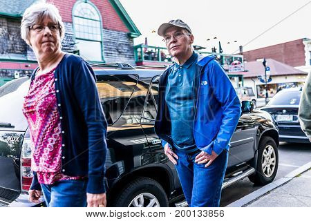 Bar Harbor USA - June 8 2017: Happy people walking in Maine downtown village in summer