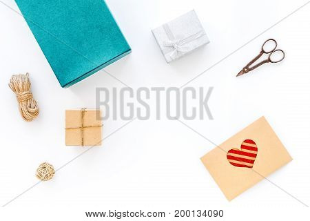 To wrap gift. Box, paper, envelope, thin cord, greeting card, ribbon, sciccors on white background top view