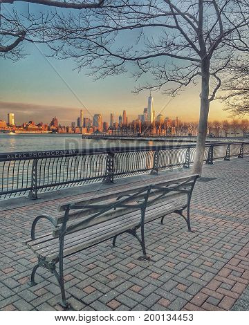 Bench is empty, please sit if you are ready to look this perfect view.