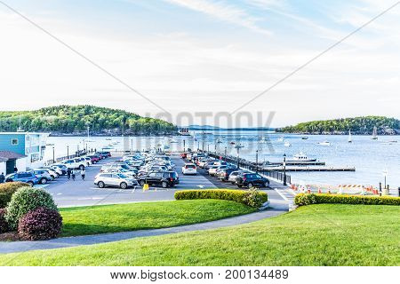Bar Harbor USA - June 8 2017: Parking lot in downtown village in summer by boats