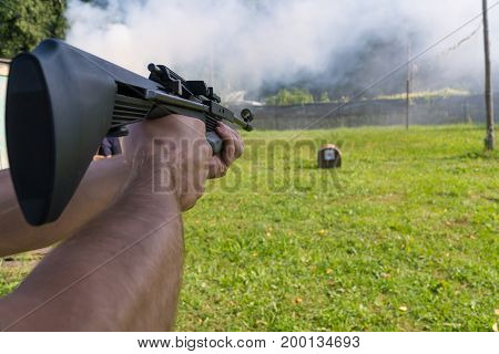 A Man Shoots A Target From A Pneumatic Gun. A View From Behind The Shoulder