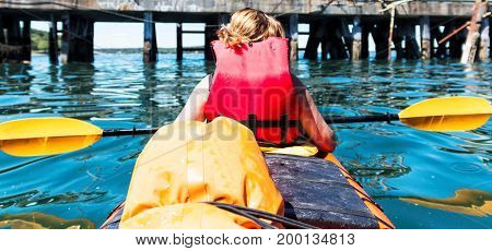 Picture from passanger of a two person kayak of the front rower from behind and looking at where the boat is going in Bar Harbor Maine.