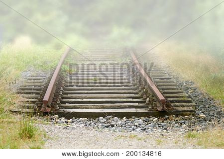 Old railway rails end in the countryside.