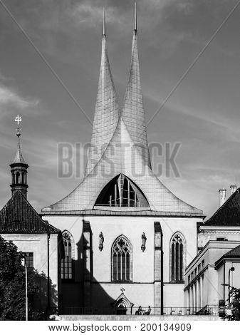 Emmaus Monastery Na Slovanech, aka Emauzy, with two modern spiky towers, Prague, Czech Republic. Black and white image.
