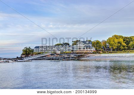 Bar Harbor USA - June 8 2017: View of dock and hotel in downtown village in summer during sunset twilight in autumn
