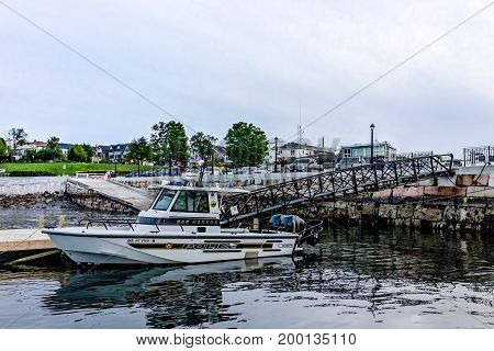 Bar Harbor USA - June 8 2017: View of dock in downtown village in summer during evening with police boat