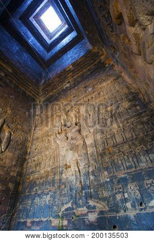 Cambodia. Siem Reap. Carved stone patterns on temple walls Banteay Srey (Xth Century) inside view