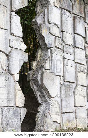 Jewish cemetery in Kazimierz Dolny Czerniawy Poland. Symbolic Wailing Wall built of tombstones destroyed by German Nazis during World War II.