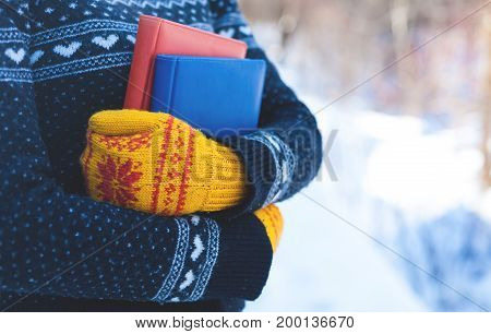 Books On The Background Of Knitted Sweaters.