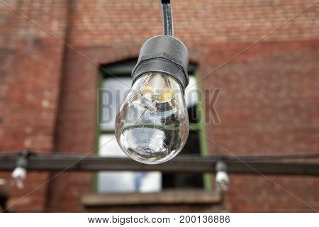 A close up of a string light bulb and socket