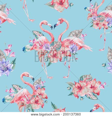 Watercolor pink flamingo and tropical flowers seamless pattern. Hand painted floral illustration with exotic flowers and birds on blue background. Fashion design elements