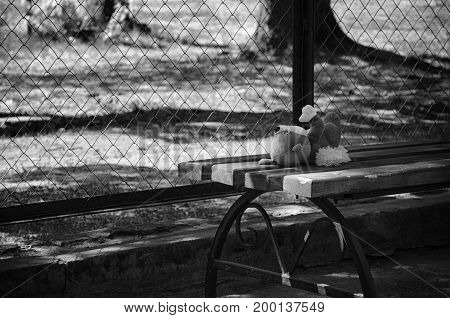 A soft toy forgotten on the playground ..