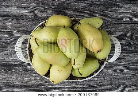 Mature pear pictures in the basket, natural and organic santa maria pear fruit pictures,