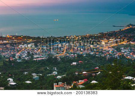 Batumi, Adjara, Georgia. Aerial View Of Urban Cityscape At Evening. Black Sea And Port In Night Illumination.
