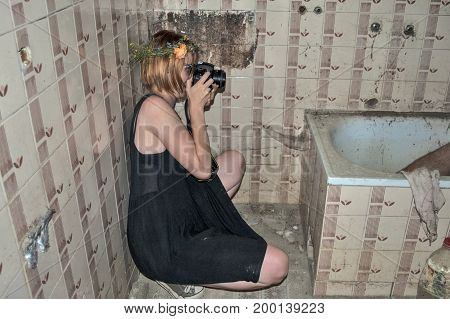 Girl With A Camera In The Bathroom