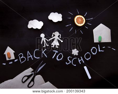 Back to school background with the children going to school. Children's creativity. Application on a blackboard. View from above