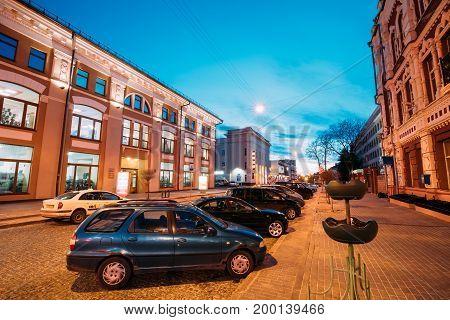 Gomel, Belarus - March 23, 2017: Cars Parking At Kommunarov Street Near Old Department Store At Evening In Night Illuminations Lights