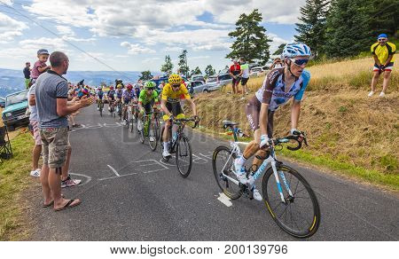 Col de Peyra Taillade France - July 162017: The group of Chris Froome in Yellow Jersey climbing the last kilometer to Col de Peyra Taillade in the Central Massif during the stage 15 of Le Tour de France 2017.