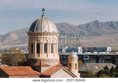 Gori, Shida Kartli Region, Georgia, Eurasia. Close Up Dome Of Cathedral Of The Blessed Virgin Mary In Sunny Autumn Day.
