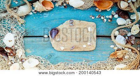 Summer Vacation Relaxation Background Theme With Seashells, Fishing Net, Rope, Stones And Weathered