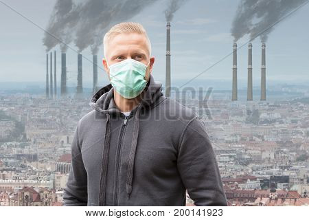 Close-up Of A Man Wearing Mouth Mask Against Smoke Emitting From Factory Chimneys