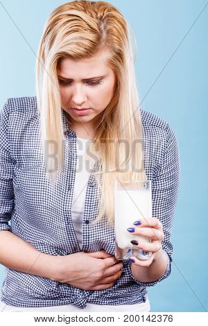 Woman Holding Milk Glass Having Stomach Ache