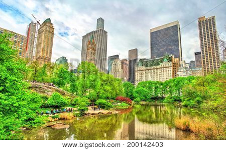 Central Park with the Pond and Manhattan Skyline - New York City, United States