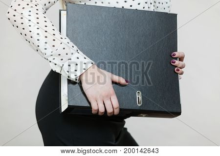 Woman Holding Black Binder With Documents