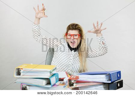 Depressed Angry Businesswoman Sitting At Desk