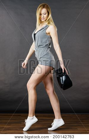 Woman Holding Boxing Gloves After Fight