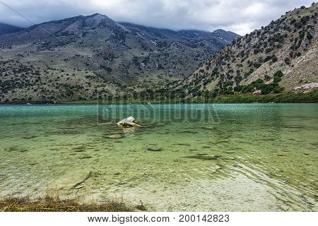 Shallow waters with clear turquoise waters of Lake Kournas (Crete Greece)
