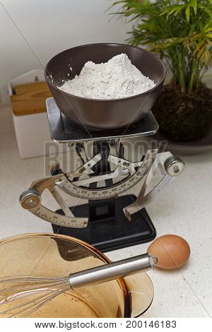 A vintage weighing scale with flour  to make pancakes