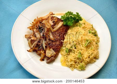 Rice Served with Cube Steaks Smothered with Fried Onions