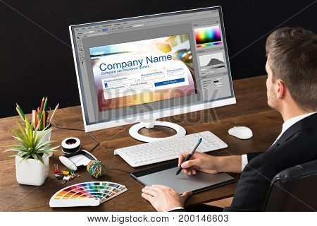 Designer Making Webpage Design On Computer Using Graphic Tablet