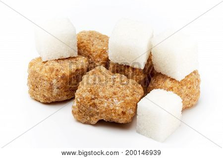Pieces Of Cane Of Brown And White Sugar On Light Background. Brown Sugar Cubes.