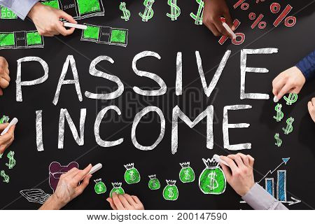 People Drawing Passive Income Concept On Blackboard