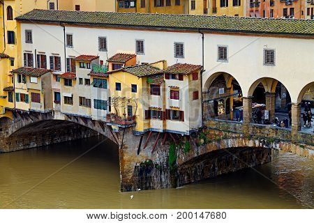 FLORENCE ITALY - JANUARY 14 2013: Detail of Ponte Vecchio full of tourists visiting. Ponte Vecchio is one of the most popular attractions in Florence.