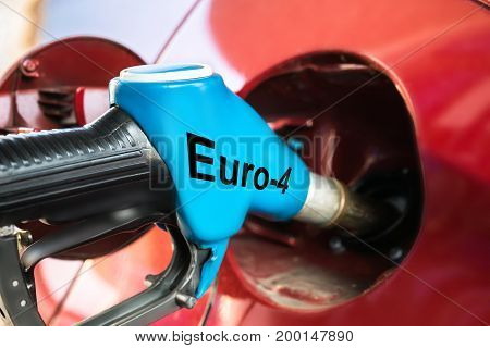 Closeup of car refueling gasoline with euro text on nozzle