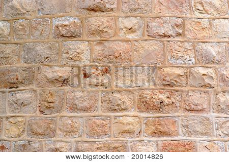 Wall built of rough stone blocks