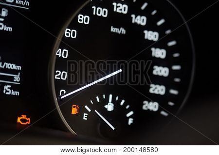 Illuminated modern car speedometer. Vehicle with empty fuel tank
