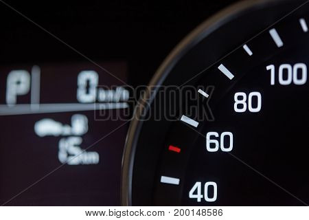 Close-up of modern car dashboard. Speedometer dial light macro