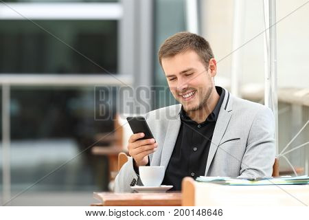 Executive Using Phone In A Coffee Shop
