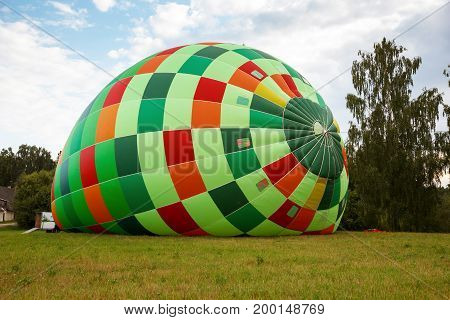 Colorful  big hot air balloon preparation for flight