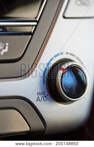 Knob of changing air conditioner temperature close up