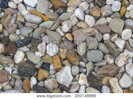 small multi color pebble stones background texture