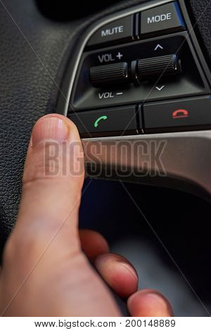 Phone buttons on car wheel close-up. Answer phone button