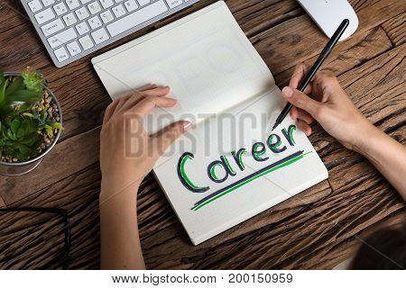 Elevated View Of A Human Hand Drawing Career Concept On Notebook