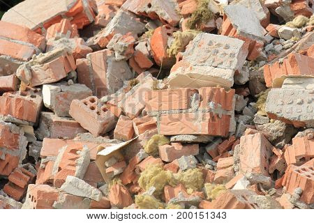 Pile of broken red bricks on construction site
