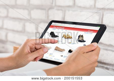 Close-up Of A Businesswoman Doing Online Shopping On Digital Tablet